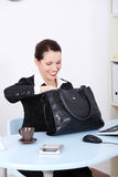 Businesswoman searching in her bag. Stock Photos