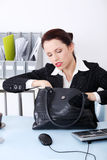 Businesswoman searching in her bag. Royalty Free Stock Image