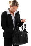 Businesswoman searching through her bag Stock Images