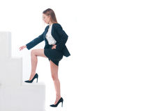 Businesswoman or secretary climbing in her society Stock Photo