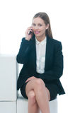 Businesswoman or secretary talking by phone Royalty Free Stock Images
