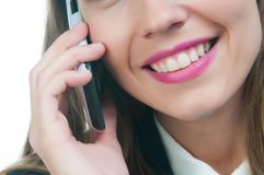 Businesswoman or secretary talking by phone Royalty Free Stock Photos