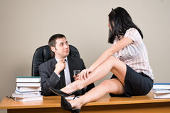 Businesswoman is seducing her boss at office Royalty Free Stock Photography