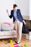 Businesswoman seeing mess in house. Young woman looking at a mess in the house after work Stock Image