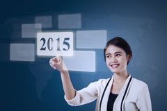 Businesswoman select number 2015 Stock Image