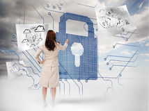 Businesswoman selecting a giant padlock Royalty Free Stock Images