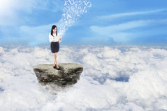 Businesswoman send message on clouds Royalty Free Stock Photos