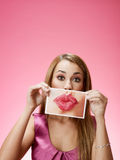 Businesswoman sending big kiss Stock Photo