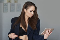 Businesswoman sending kisses by tablet Royalty Free Stock Photo