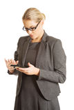 Businesswoman sending a message Stock Photo