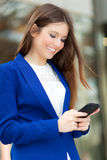 Businesswoman sending a sms Royalty Free Stock Images