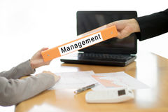 Businesswoman sends the debtor document to the businessman. Selective focus Stock Photography