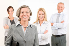 Businesswoman senior with colleagues in the back Royalty Free Stock Image