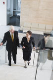 Businesswoman and senior executive walking. Stock Images
