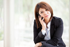 Businesswoman on a serious call Stock Photos