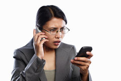Businesswoman serious expression using video call Royalty Free Stock Photo