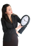 Businesswoman seriously looking at clock Stock Photography