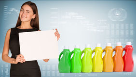 Businesswoman and several multi-colored bottles Royalty Free Stock Photos