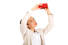 Businesswoman Shaking A Wallet. Royalty Free Stock Photography