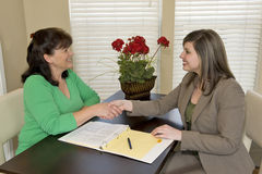 Businesswoman Shaking Customer's Hand Stock Images