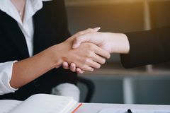 Businesswoman shaking hand for a complete business deal together. Successful.Finishing up a meeting. Teamwork and Partnership concept stock photography