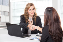 Businesswoman shaking hand after a long negotiation Stock Image