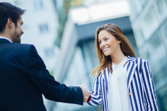 Businesswoman shaking hand Stock Images