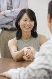 Businesswoman shaking hands Stock Image