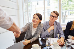 Businesswoman shaking hands as a welcome gesture Stock Photos