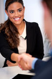 Businesswoman shaking hands with a client Royalty Free Stock Photo