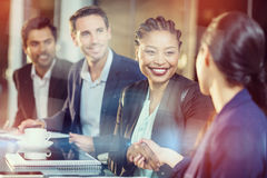 Businesswoman shaking hands with colleague Royalty Free Stock Image