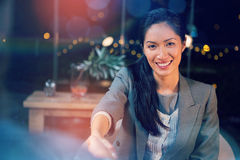 Businesswoman shaking hands with colleague. Portrait of businesswoman shaking hands with colleague in office Royalty Free Stock Photo