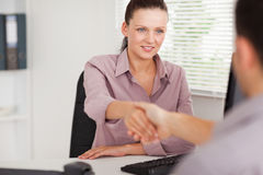 Businesswoman shaking hands with customer Stock Photography