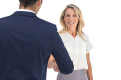 Businesswoman shaking hands and looking at the camera Royalty Free Stock Photo