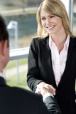 Businesswoman shaking hands with male client or colleague Stock Photography