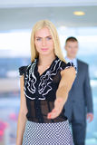 Businesswoman shaking hands in office Royalty Free Stock Image