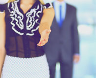 Businesswoman shaking hands in office Royalty Free Stock Images