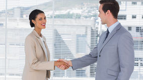 Businesswoman shaking hands to businessman Royalty Free Stock Image