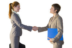 Businesswoman shaking hands together Stock Photo