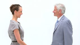 Businesswoman shaking a mans hand. Against white background stock video footage