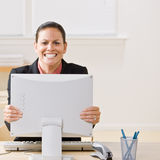 Businesswoman shaking monitor. Businesswoman shaking her computer monitor Royalty Free Stock Photography