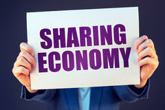 Businesswoman with Sharing economy banner Royalty Free Stock Photography