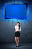 Businesswoman with shining tablet Royalty Free Stock Photos