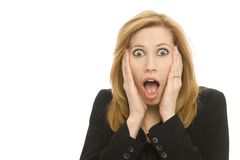 Businesswoman in shock. A businesswoman in a suit gestures suprise Stock Images