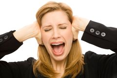 Businesswoman in shock. A businesswoman in a suit covers her ears while gesturing surprise Royalty Free Stock Photos