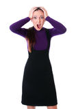 Businesswoman is shocked. Isolated at white background Royalty Free Stock Image