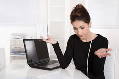 Businesswoman shocked about increasing costs. Stock Photography