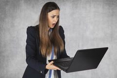 Businesswoman shocked by the information on the web. Business woman shocked by the information on the web royalty free stock image