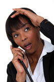 Businesswoman shocked by news Royalty Free Stock Photography