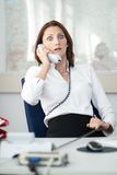 Businesswoman is shocked at the phone Royalty Free Stock Photo